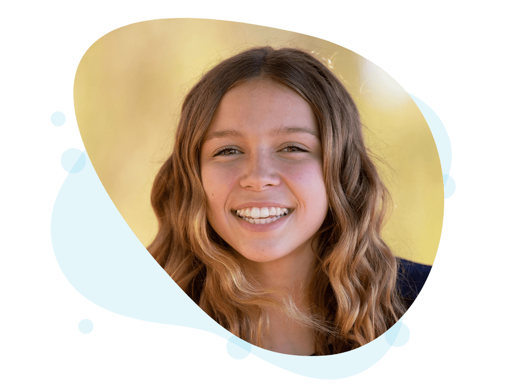Young woman smiling with Invisalign